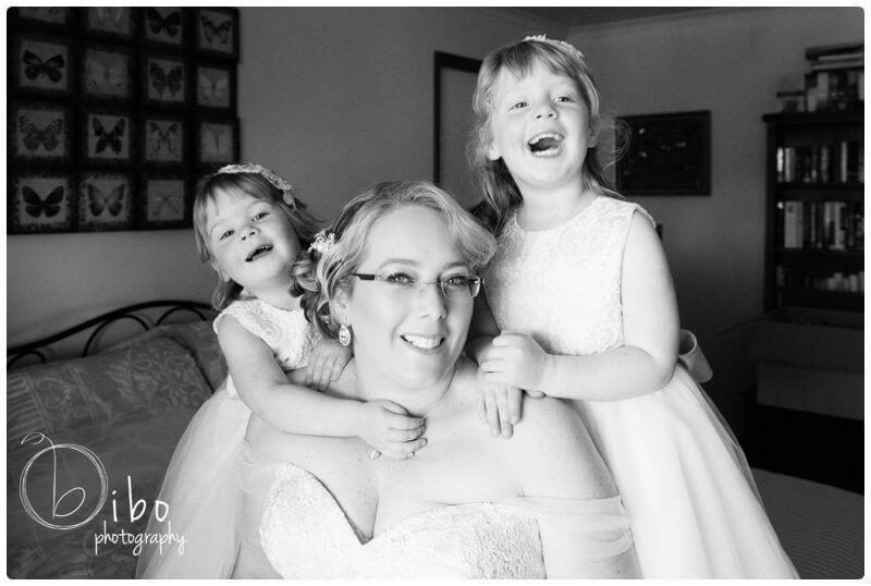 Bride with daughters before wedding