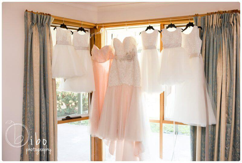 Wedding gowns hanging in window